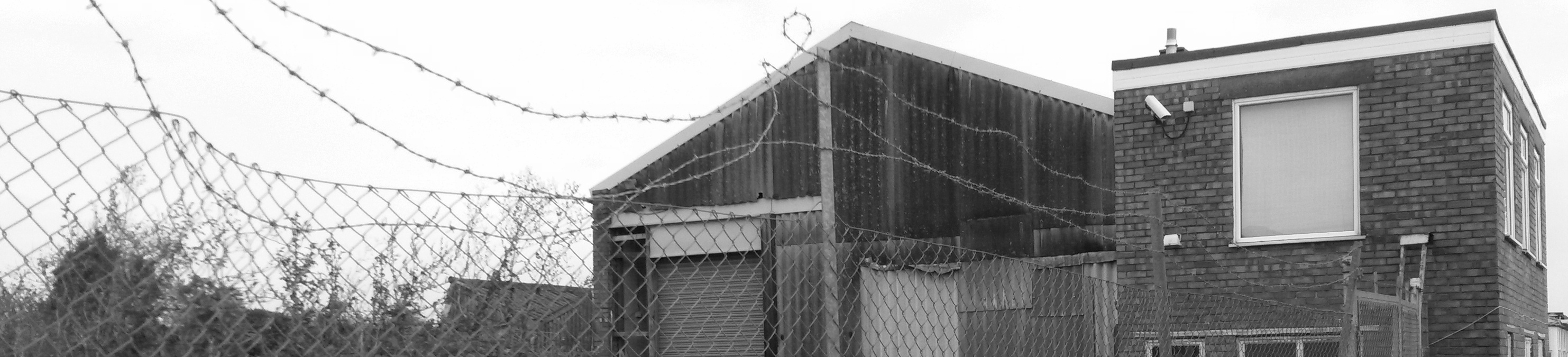 Security Industry - A building behind some security fencing